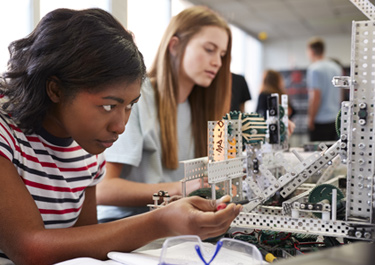 Two students working with robotics